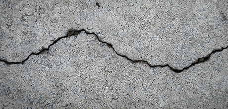Structural damage from faulty building pad not covered under a Kentucky CGL policy
