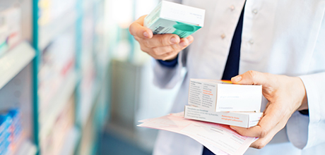 Pharmacist holding prescriptions